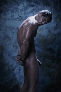 Naked man in prison